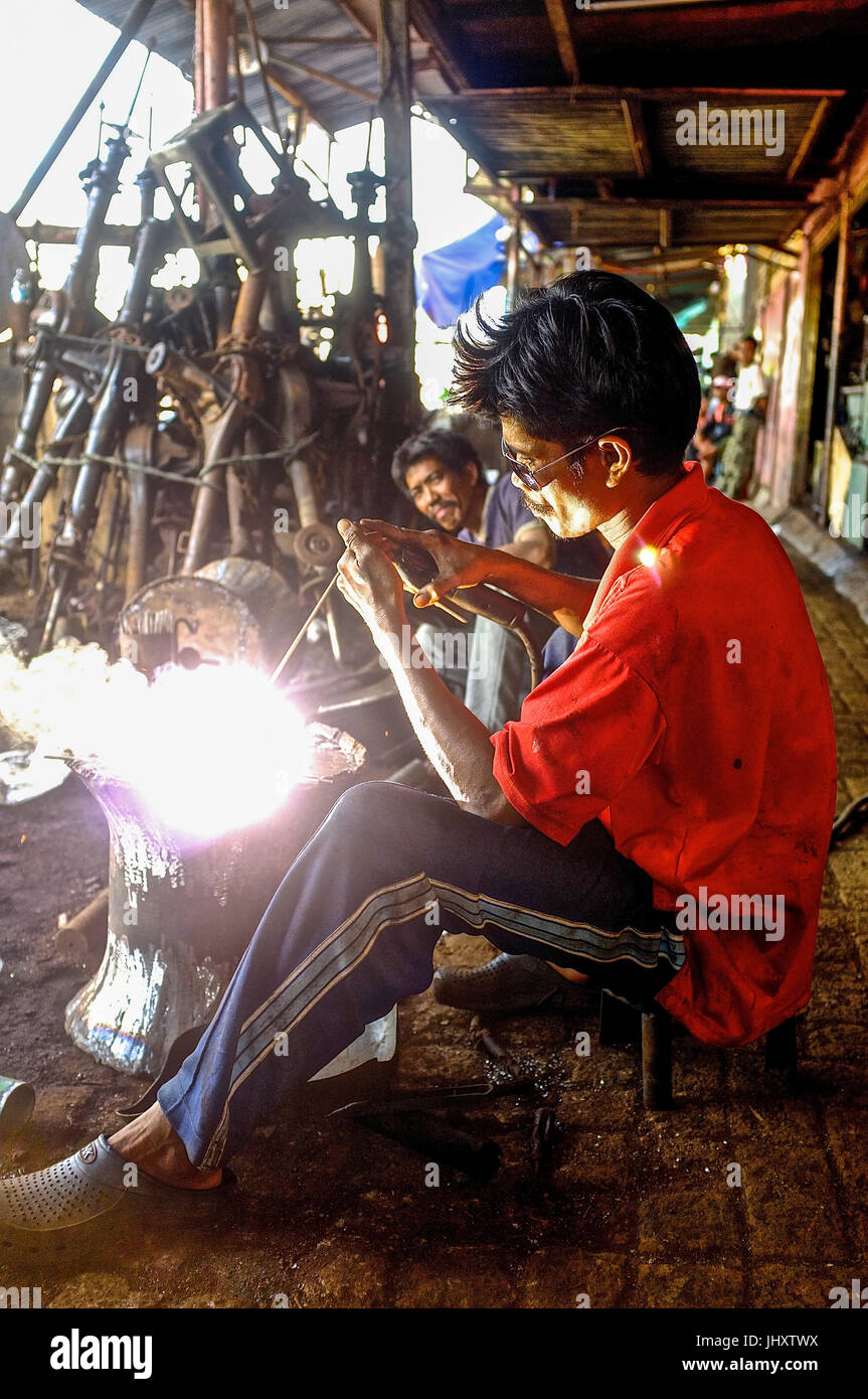 A metal worker uses a blowtorch in Makassar, South Sulawesi, Indonesia - Stock Image