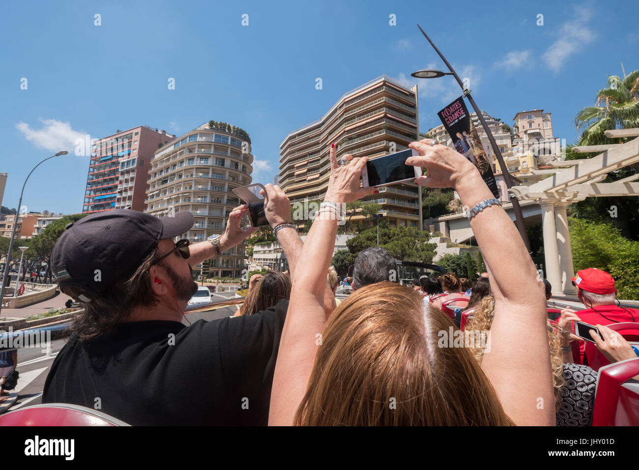 Tourists on a guided tour with a Hop on Hop off bus, Monte Carlo, Monaco. - Stock Image