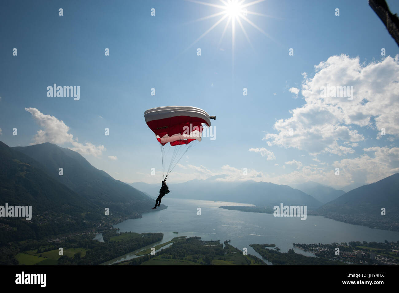 Skydiver flying his parachute above the Para Centro Locarno in Switzerland - Stock Image