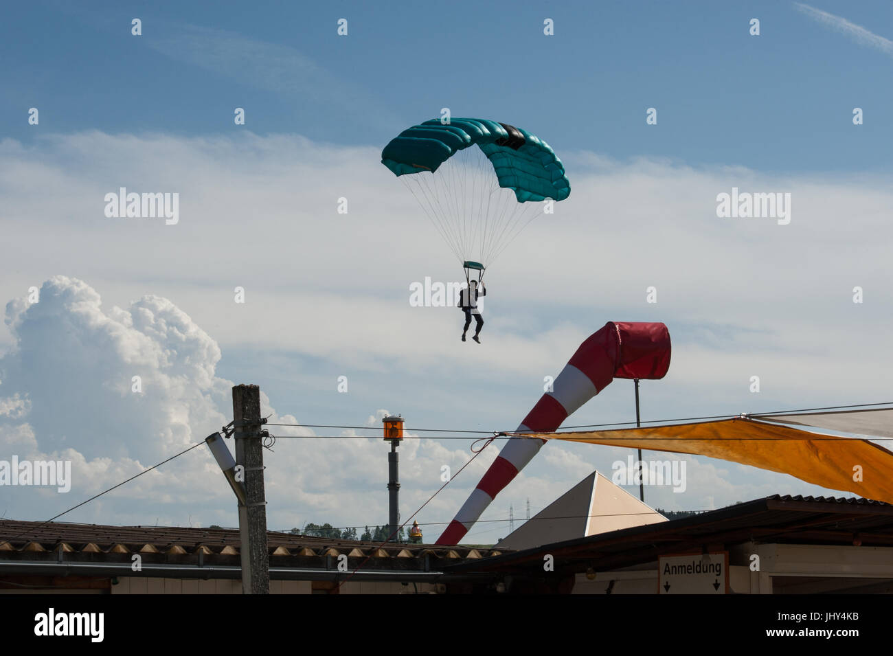 A student skydiver on final approach for his landing at Beromunster, Switzerland - Stock Image