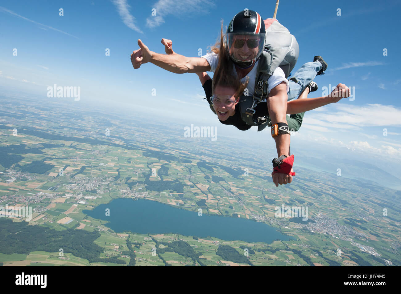 Girl doing a first tandem skydive - Stock Image