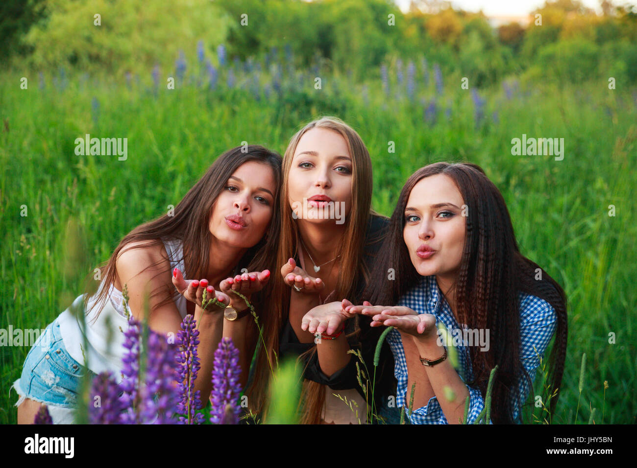 Three Beautiful Young Happy Girls Best Friends Send An Air Kiss Stock Photo Alamy