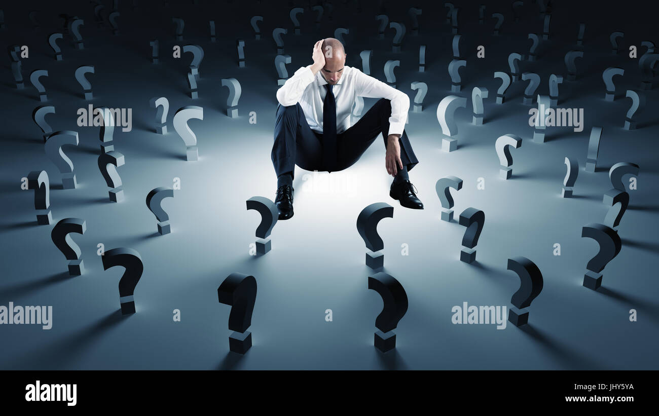 Businessman with many question marks. Concept of failure and problem - Stock Image