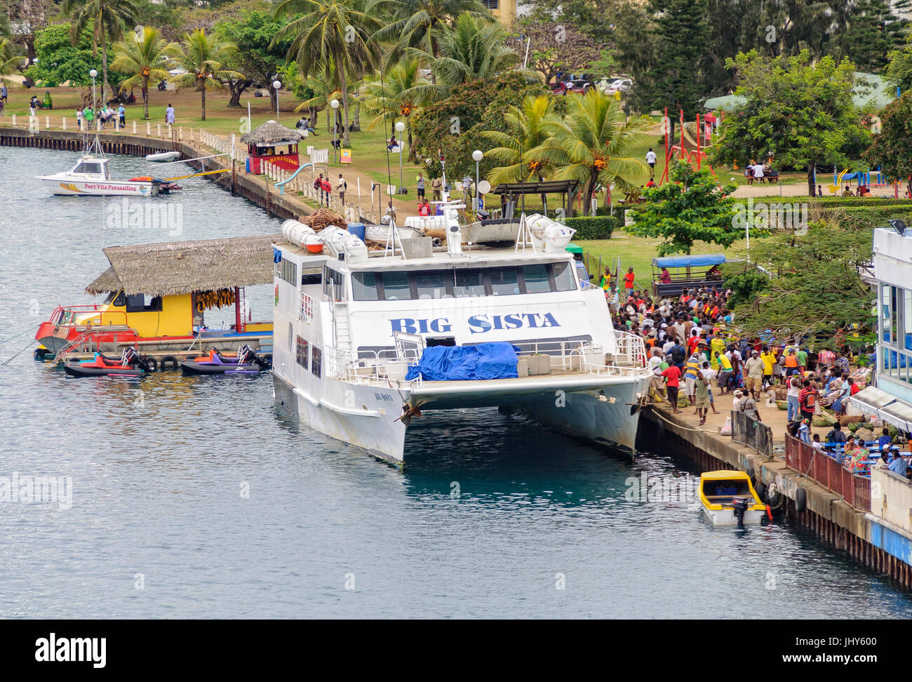 Big Sista, a 33m  passenger vessel, has arrived on its weekly run from Luganville Santo to the harbour in front - Stock Image