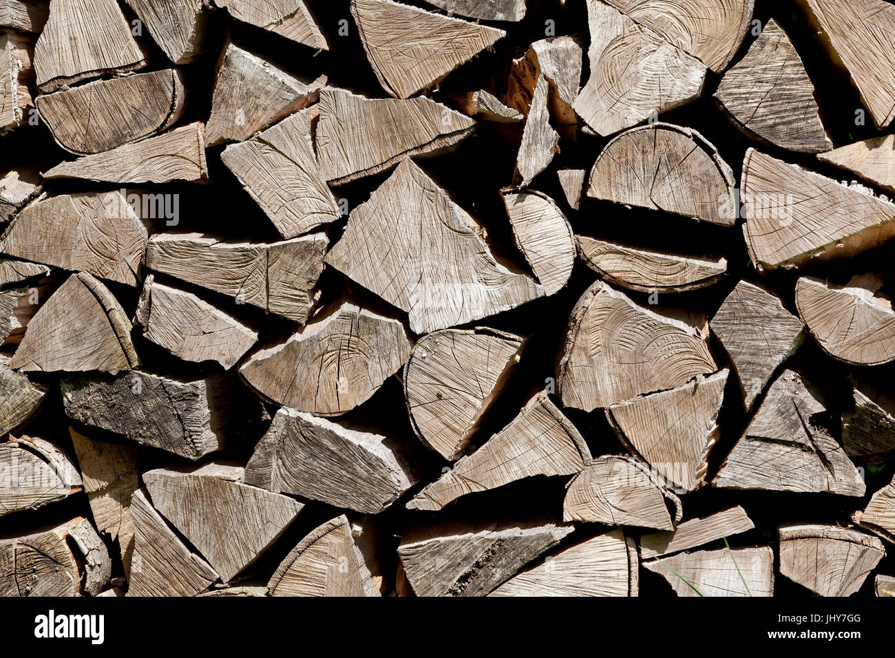 Firewood pile, fire wood, wooden pile - stack of firewood, Brennholzstapel, Feuerholz, Holzstapel - Stack of firewood - Stock Image