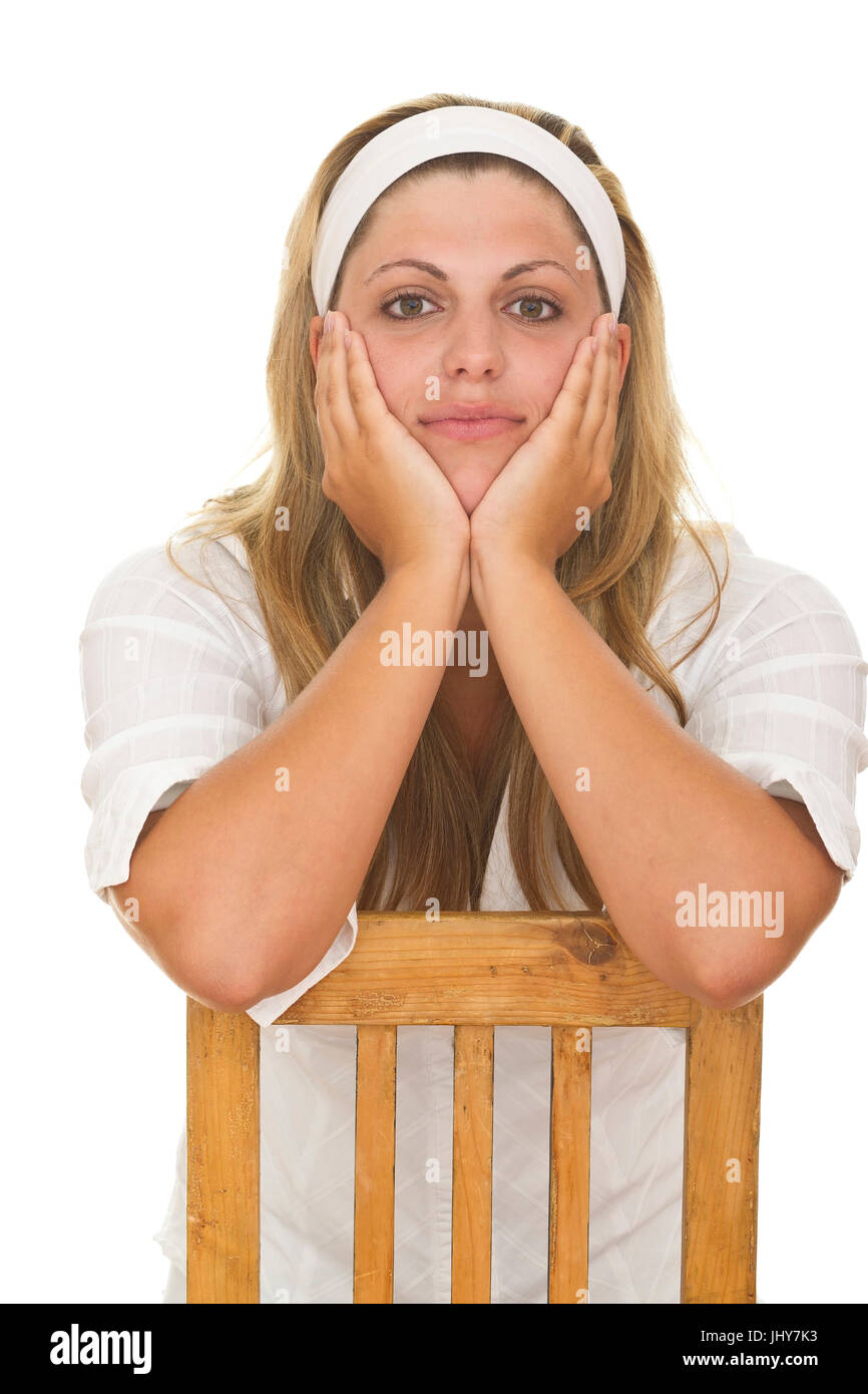 Young woman supports the head in the hands - Young woman, face resting in here hands, Junge Frau stützt den - Stock Image