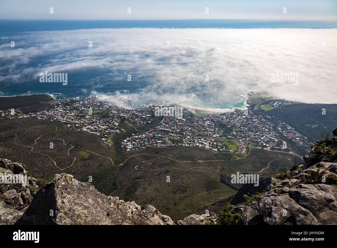 The view from Table Mountain over Camps Bay covered in low cloud, Cape Town, South Africa, Africa - Stock Image