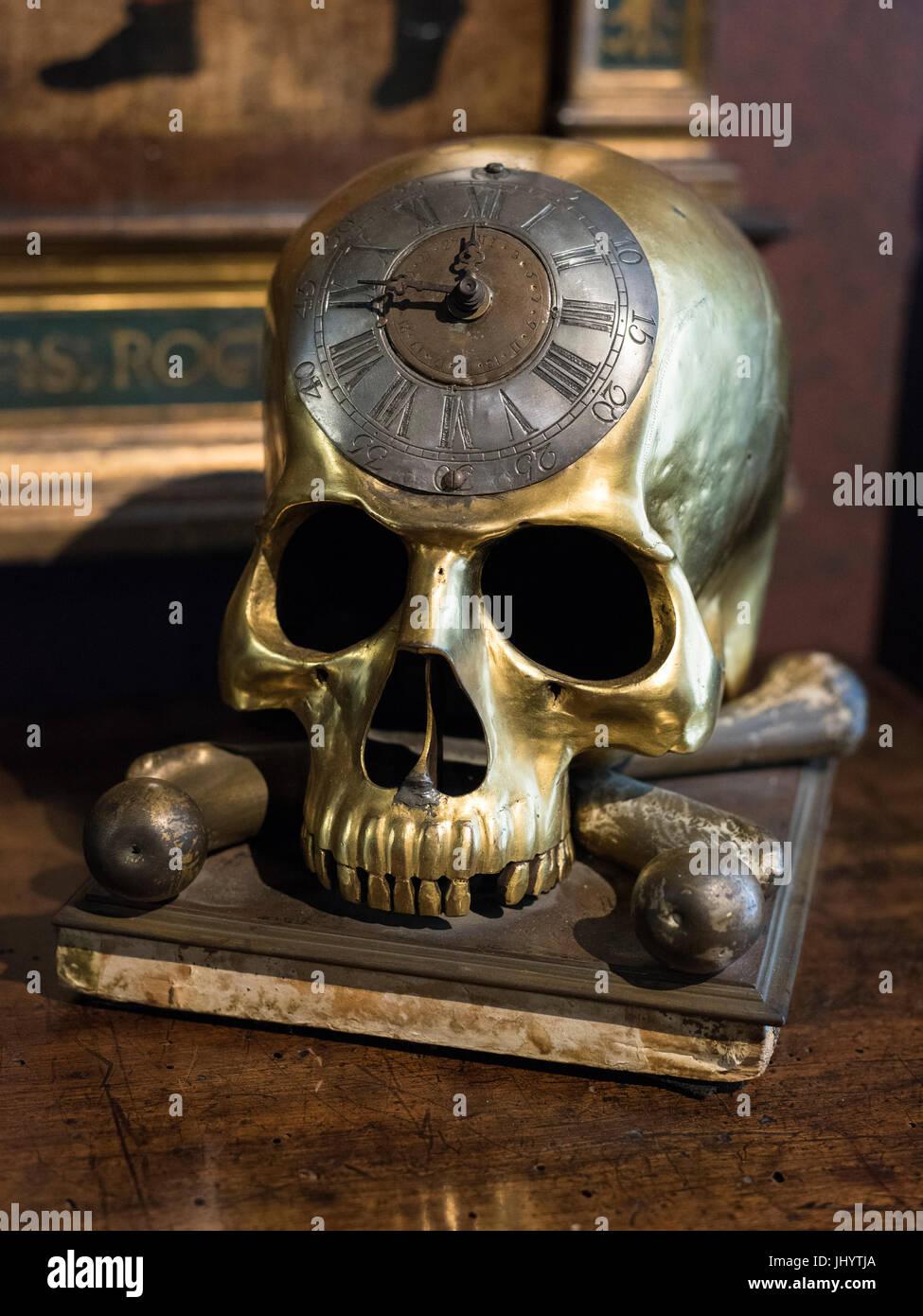 Milan. Italy. Museo Bagatti Valsecchi Museum, 'Memento mori' skull and crossbones clock at Fausto Bagatti - Stock Image