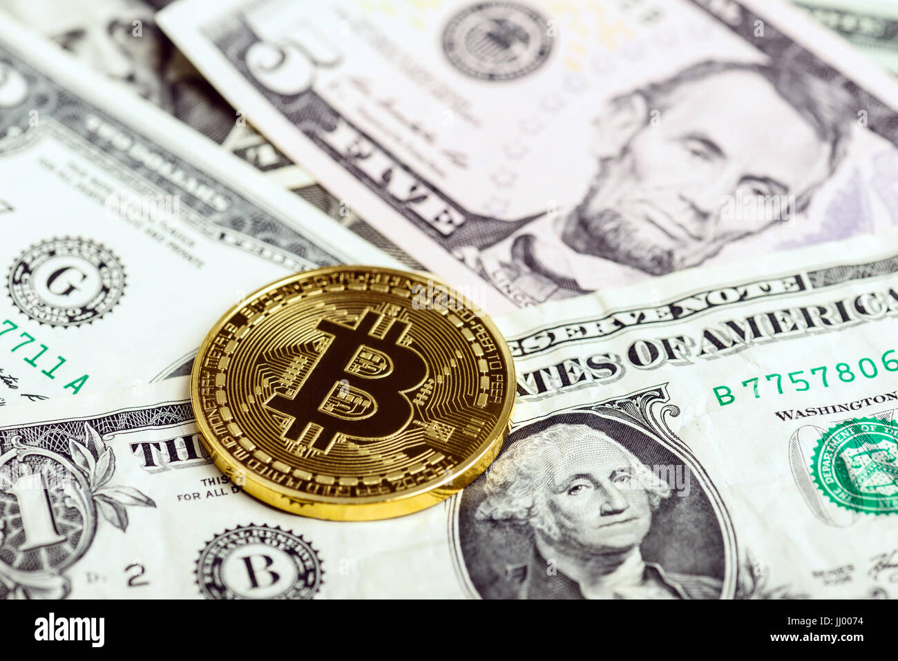 Bitcoin coin over money background - Stock Image