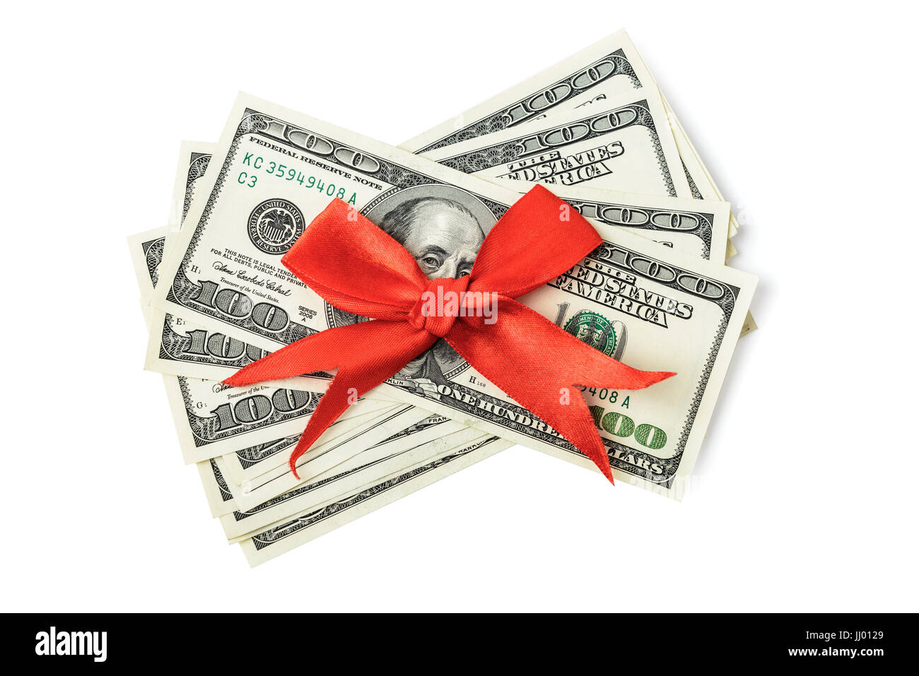 Dollars with red bow isolated on white - Stock Image
