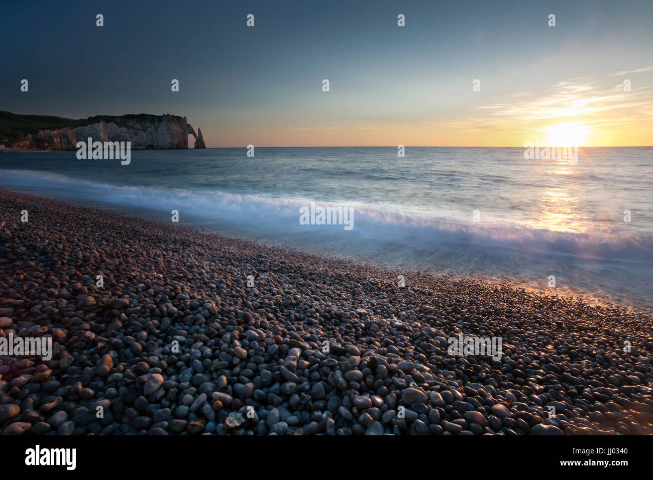 Sunset at Etretat beach - Stock Image