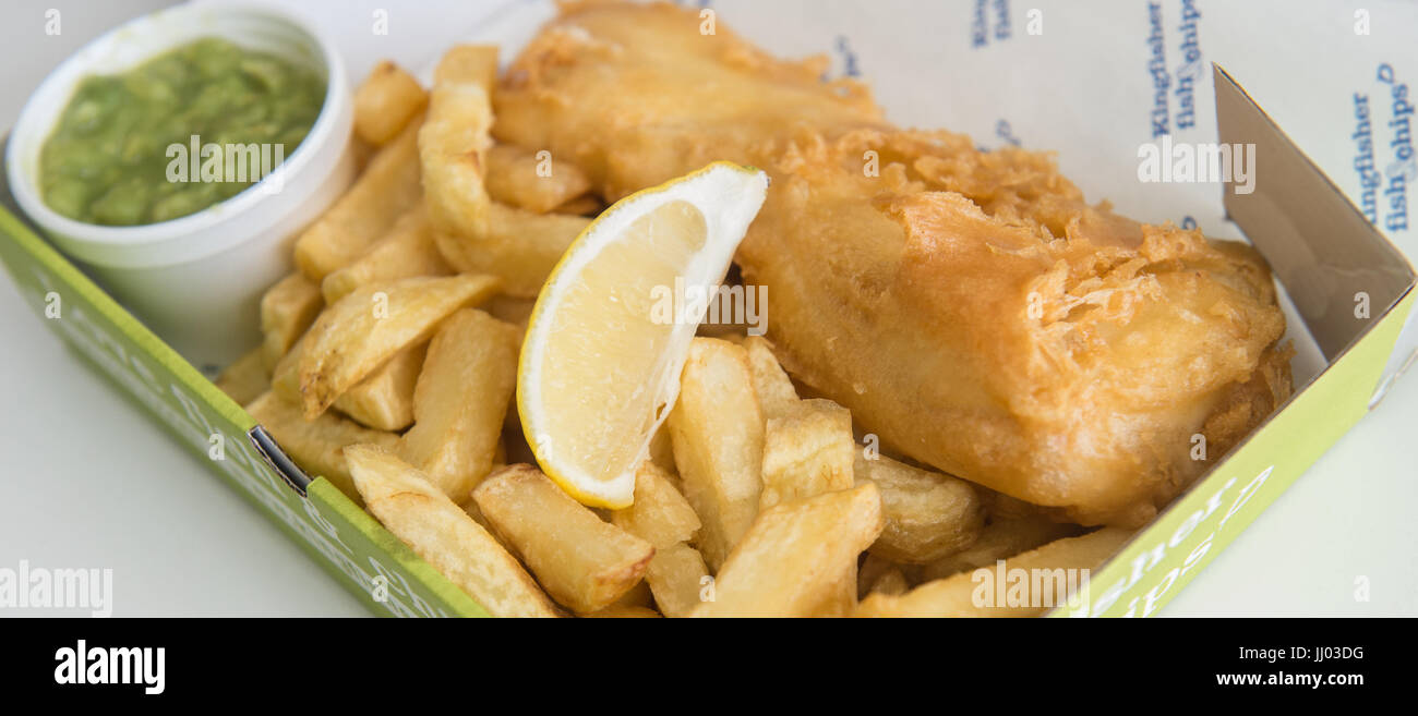 Copyrighted Image by Paul Slater/PSI -  Traditional British Food - Fish and Chips and Mushy Peas. Stock Photo