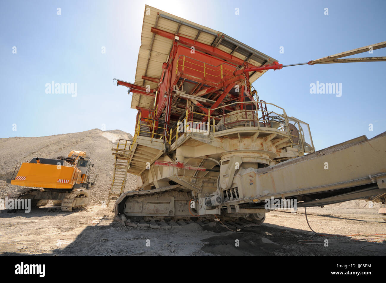 Stonecrusher and conveyor belt equipment in a chalk quarry. - Stock Image