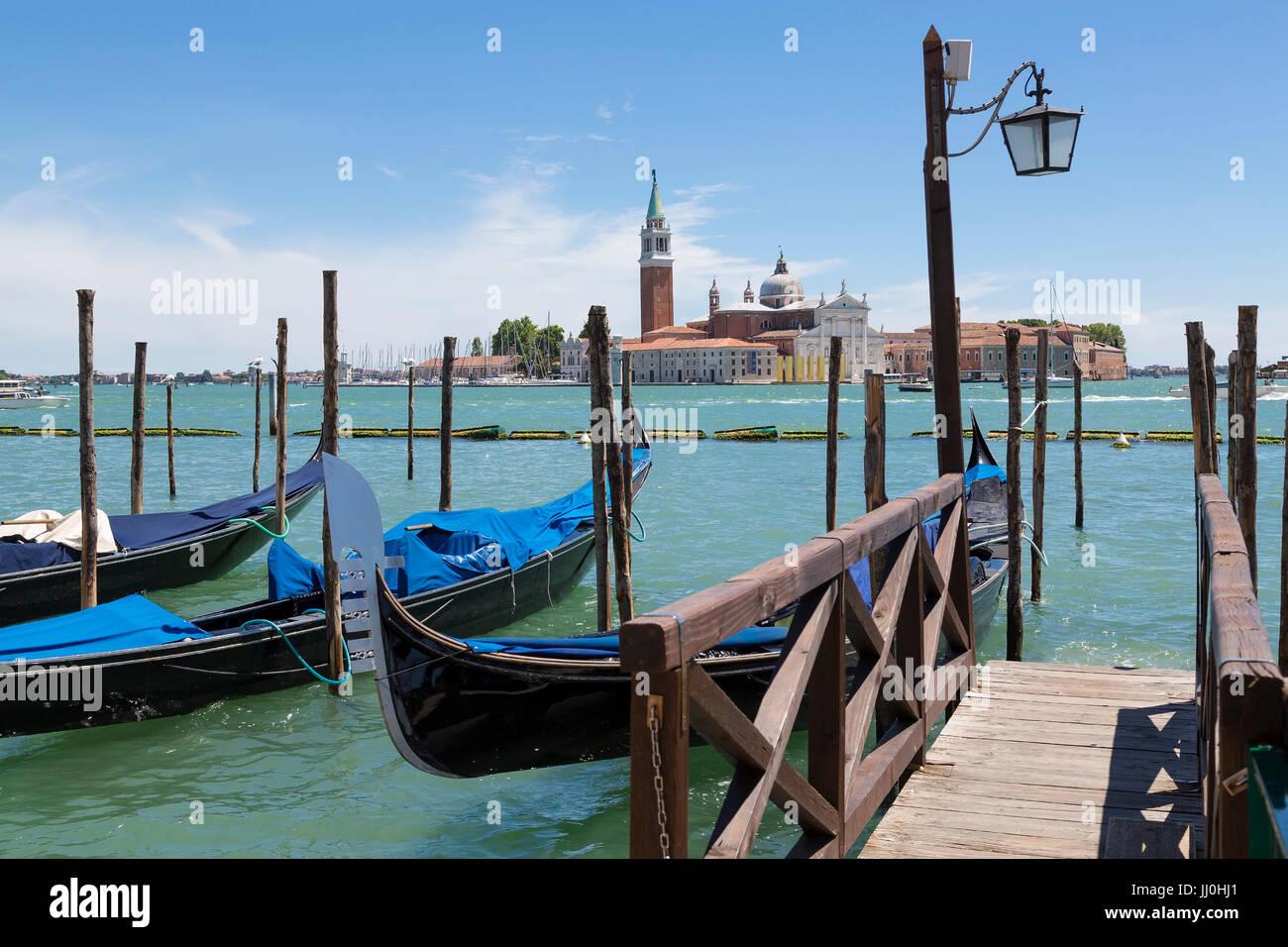 Gondolas in the Riva degli Schiavoni, Venice, Veneto, Italy - Gondolas At Riva degli Schiavoni, Venice, Venetia, - Stock Image
