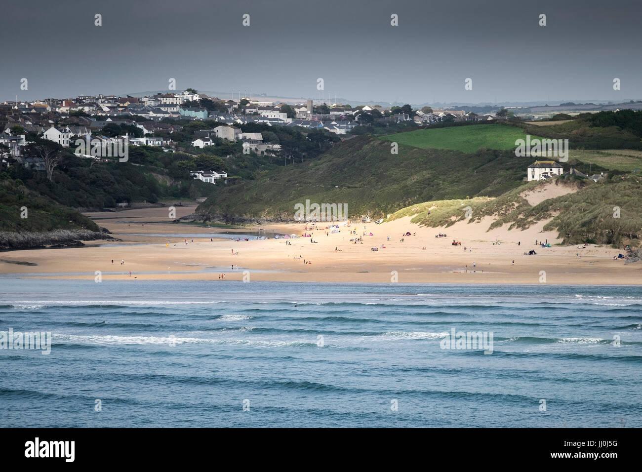 Sunlight shining on Crantock Beach seen from West Pentire Headland. - Stock Image