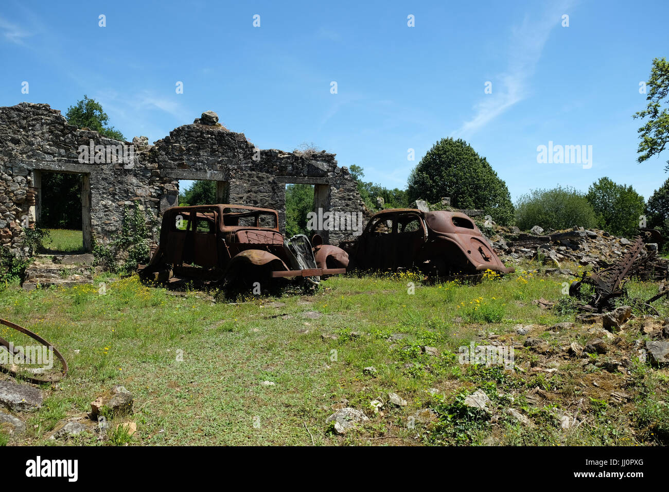 Oradour:  site of Nazi Massacre - crumbling buildings and rusting cars - left intact as it was on the order of General Stock Photo