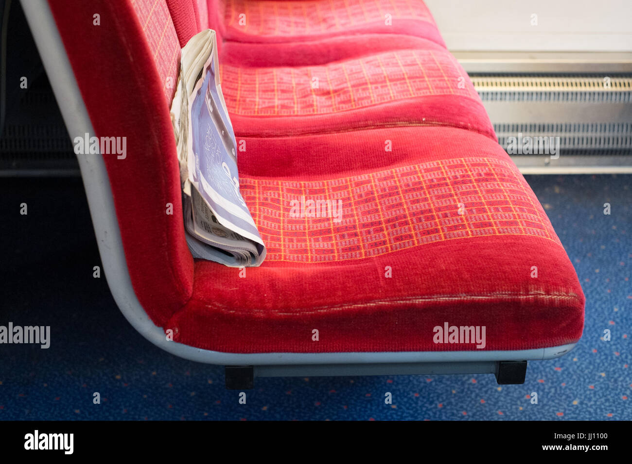 Free newspaper left on a train seat, Waterloo station, London, England. - Stock Image