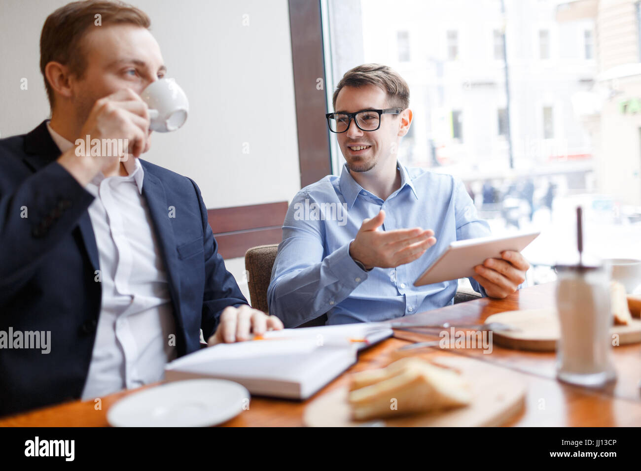 Talking by lunch - Stock Image