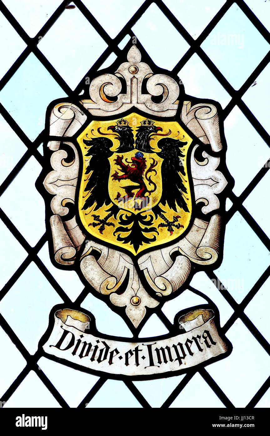 Divide et Impera, Divide and Rule, heraldic, heraldry, motto, stained glass, East Barsham Manor, Norfolk , England, - Stock Image