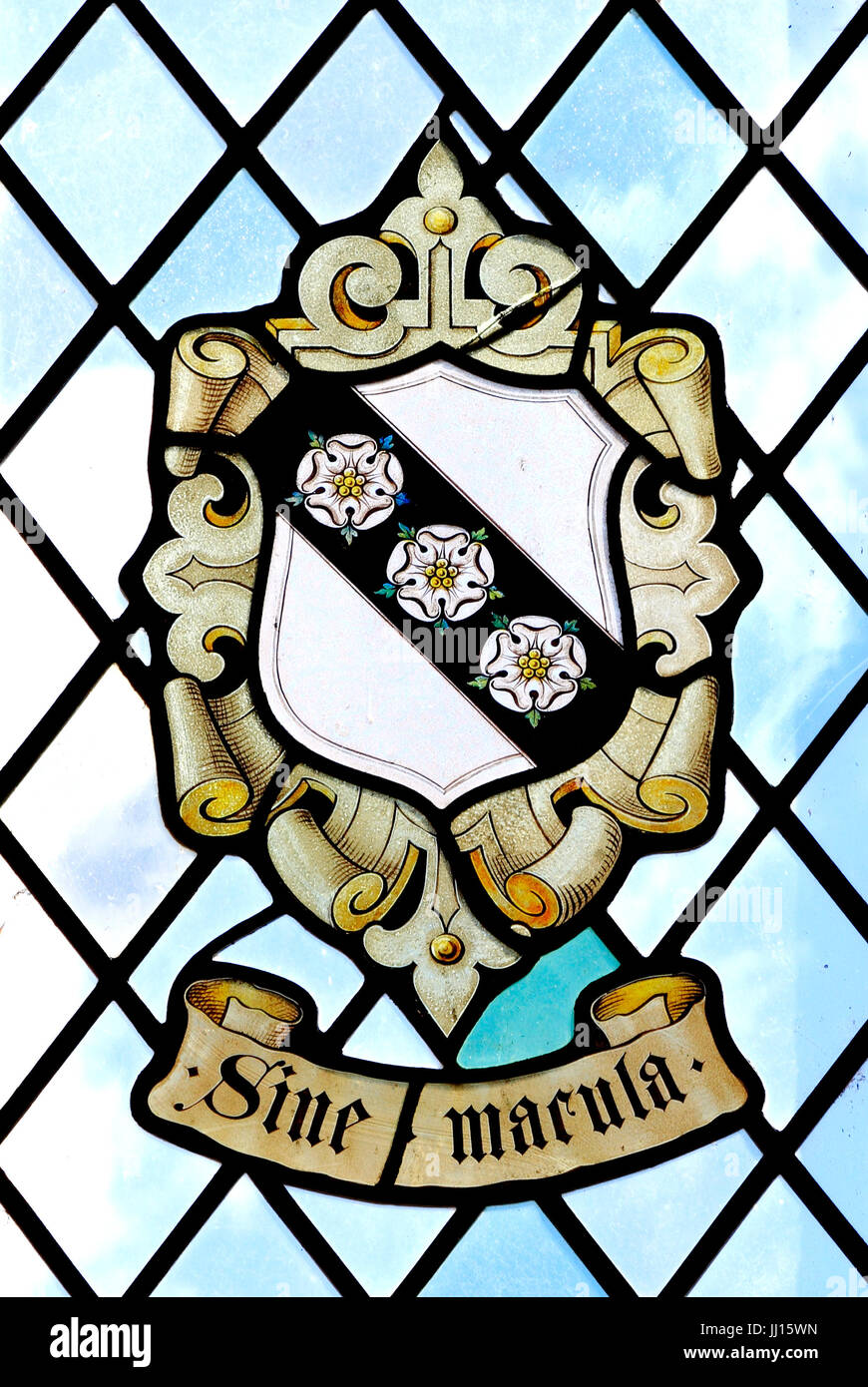 Sine Macula, Without Blemish, Without Stain, heraldic, heraldry, stained glass window of the Carey Family, East - Stock Image