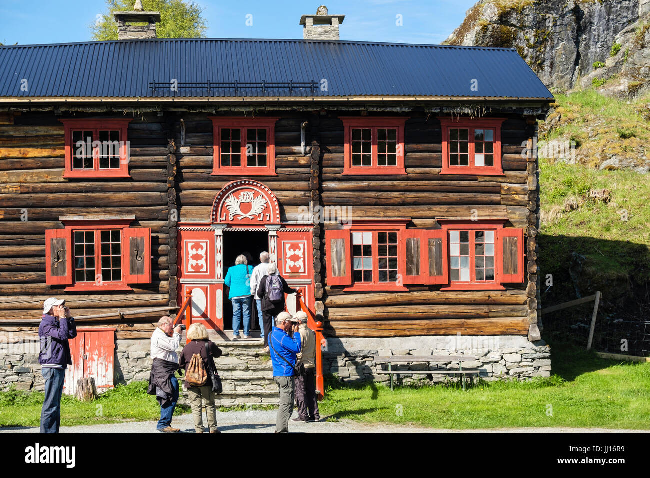 Tourists visiting 19th century traditional Norwegian wooden farmhouse circa 1817 in Sverresborg Trøndelag Folk - Stock Image