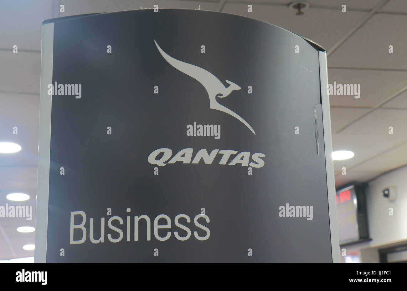 Qantas business class check in sign at Melbourne airport Australia. - Stock Image