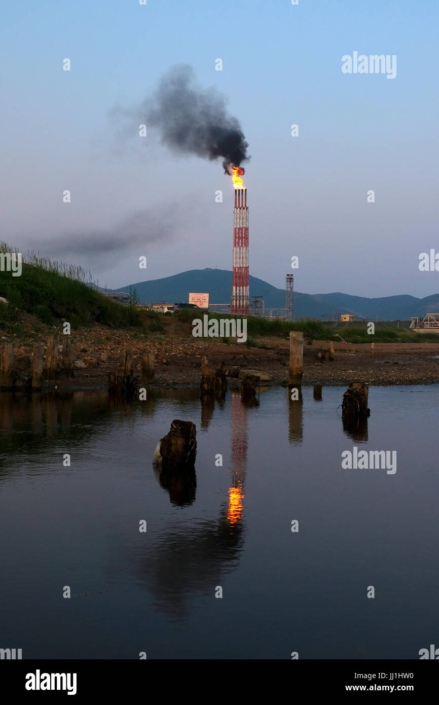 A flare stack burning off excess gas at a liquefied natural