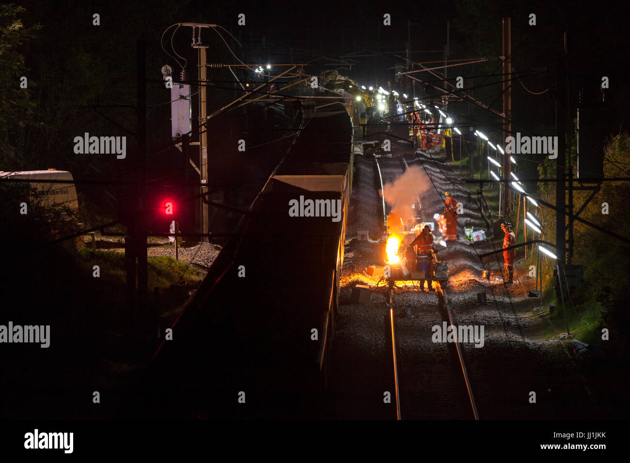 Bay Horse (South of Lancaster)  thermite welding rails during night time  track renewal engineering work  on west - Stock Image