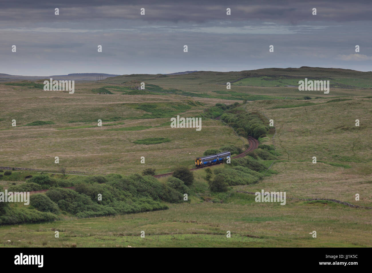 The  0702 Stranraer - Glasgow central Scotrail train  passes Glenwhilley, south of Barrhill, on the single track - Stock Image