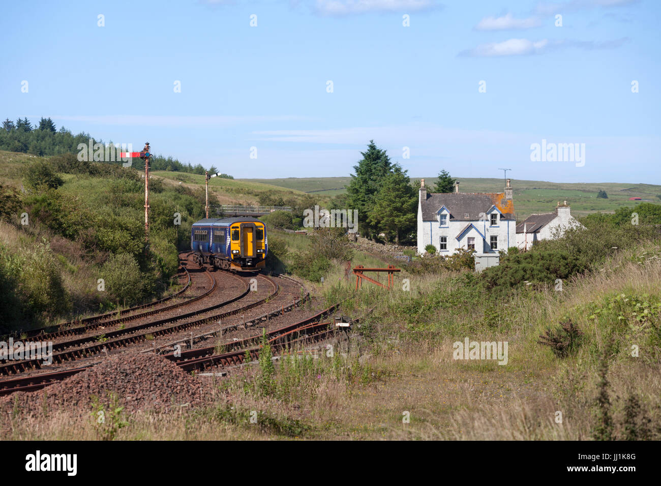 Scotrail class 156 sprinter train at the isolated passing loop at Glenwhilley on the rural railway line to Stranraer - Stock Image