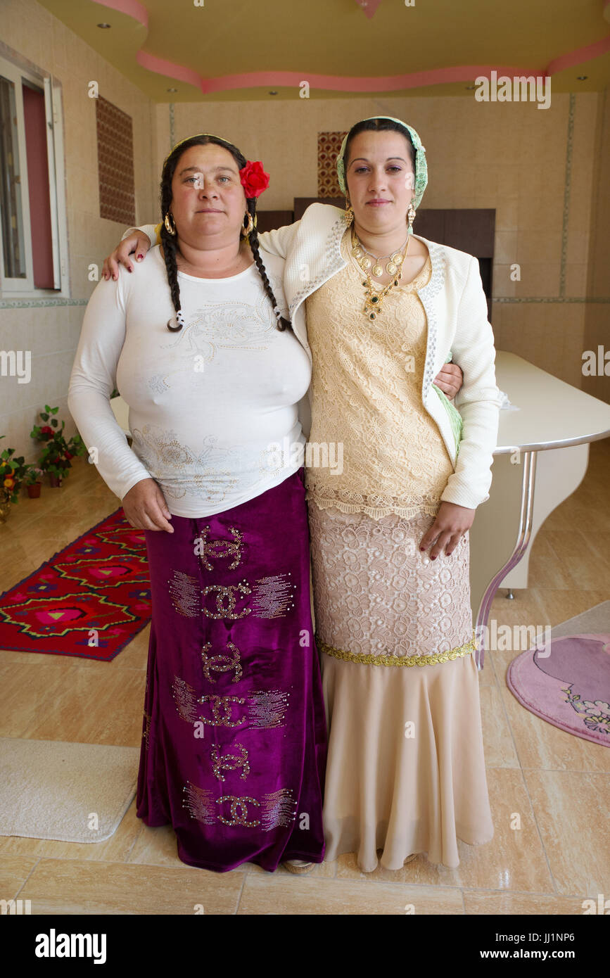 Two women of a wealthy Roma gypsy family posing inside their luxury house, Ivanesti, Romania - Stock Image