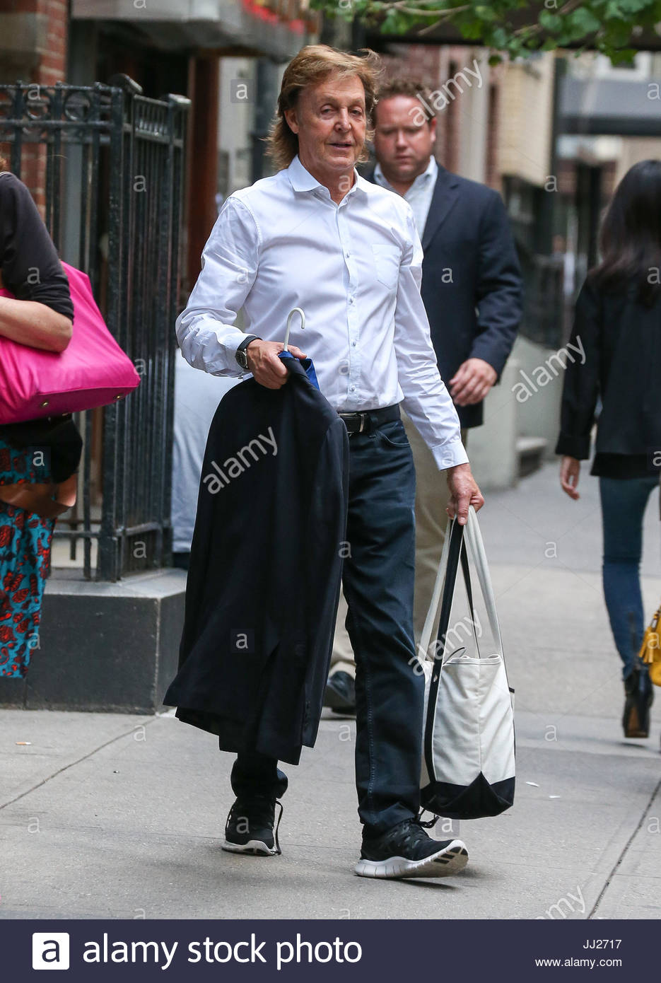 Paul McCartney With His Daughter Beatrice Leaving A Building In Manhattan New York City