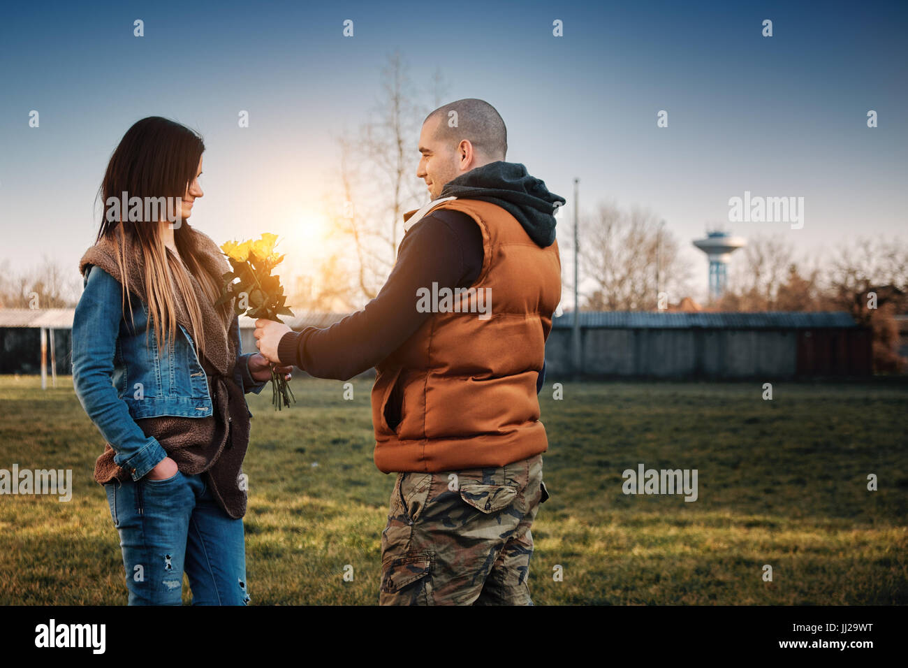 Young couple date in the park - Stock Image