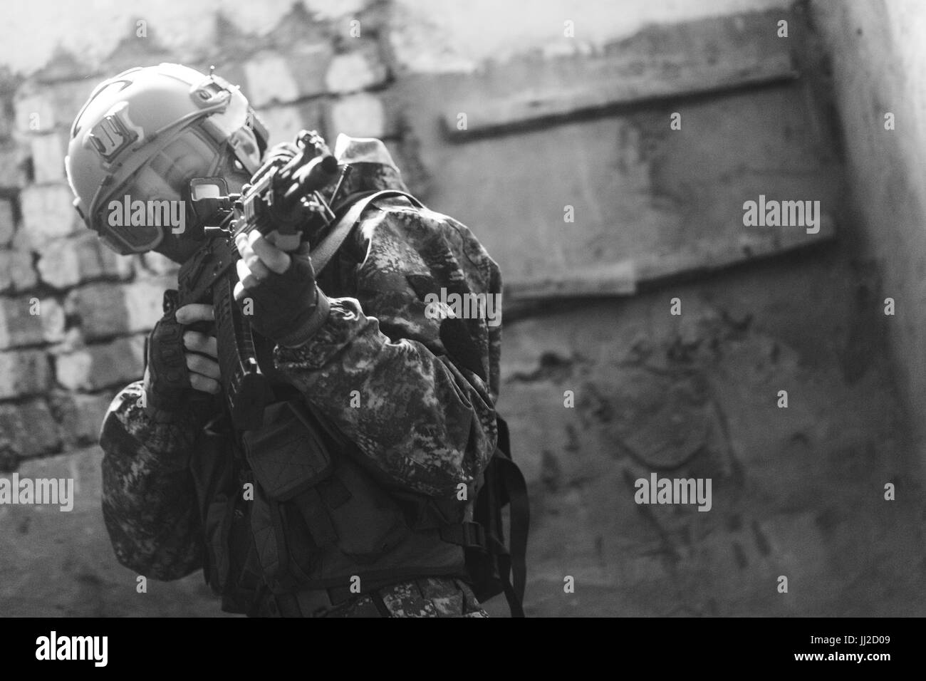 Photo of soldier with weapons - Stock Image