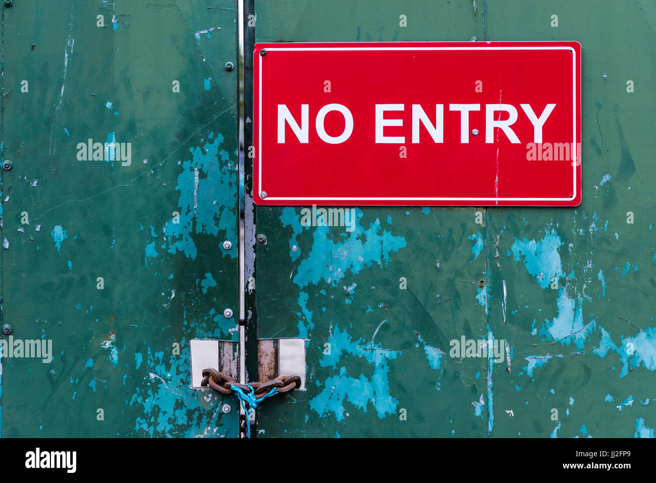 Locked steel door at an industrial site saying 'No Entry' - Stock Image