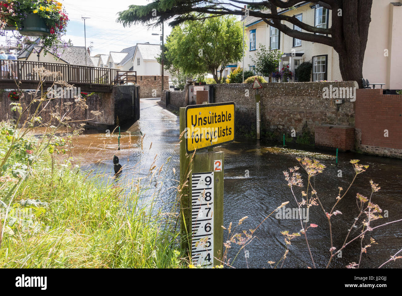 Sign saying 'unsuitable for cyclists' at the ford across the river Sid at Sidmouth, Devon. - Stock Image