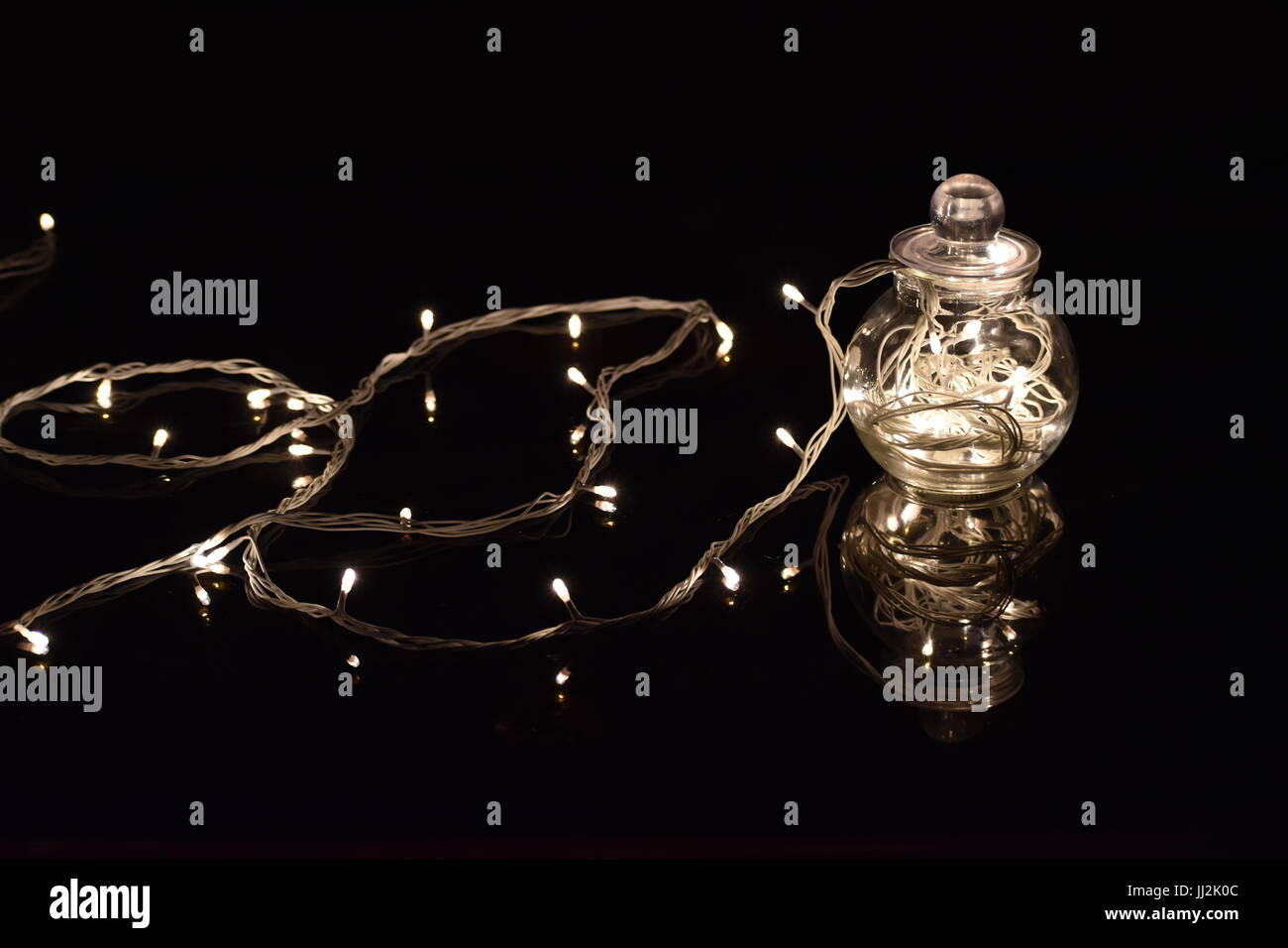transparent spherical jar with fairylights - Stock Image