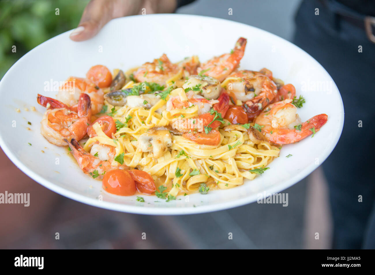 Shrimp and Garlic on fresh pasta, Legal Sea Foods restaurant, Boston, MA, USA - Stock Image