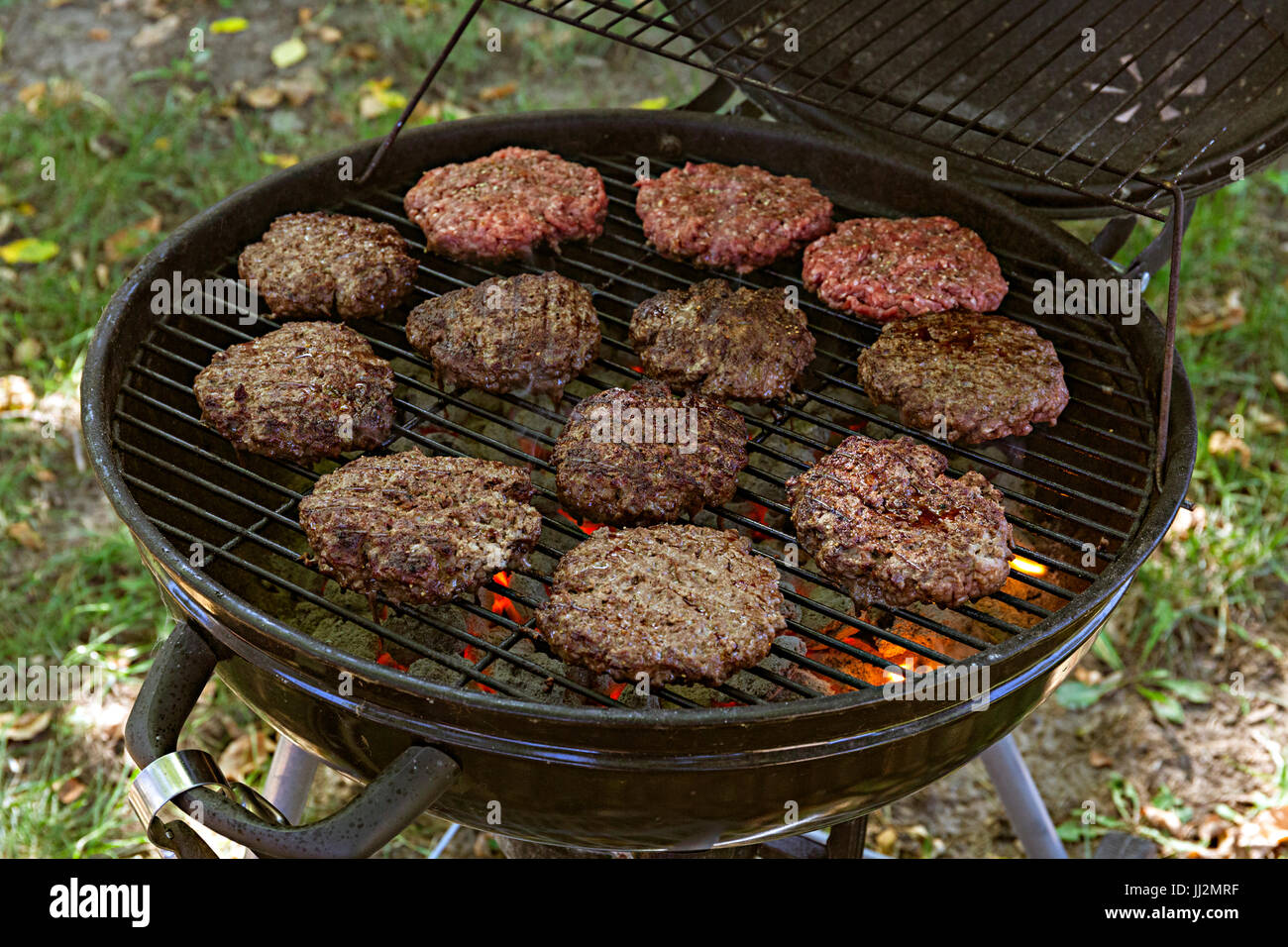 Hamburgers On A Charcoal Grill Stock Photo Alamy