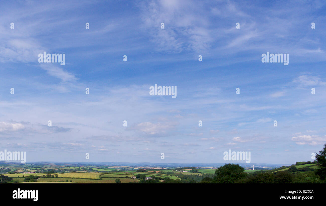 Open view looking across meadows and pastures on a summer afternoon in England - Stock Image