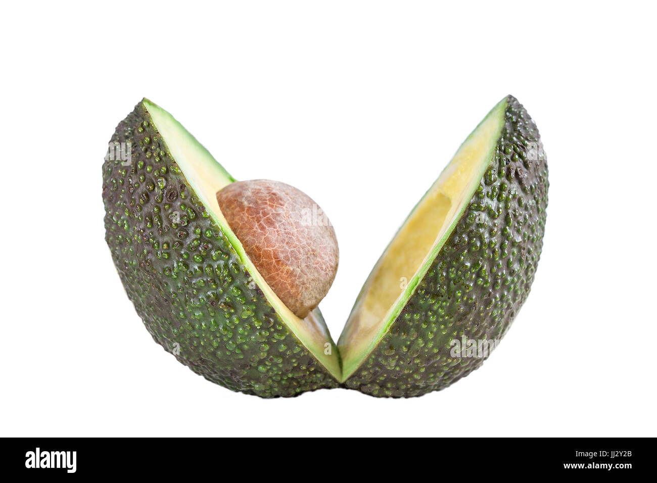 Two slices of avocado isolated Cut in v profile view one with core - Stock Image