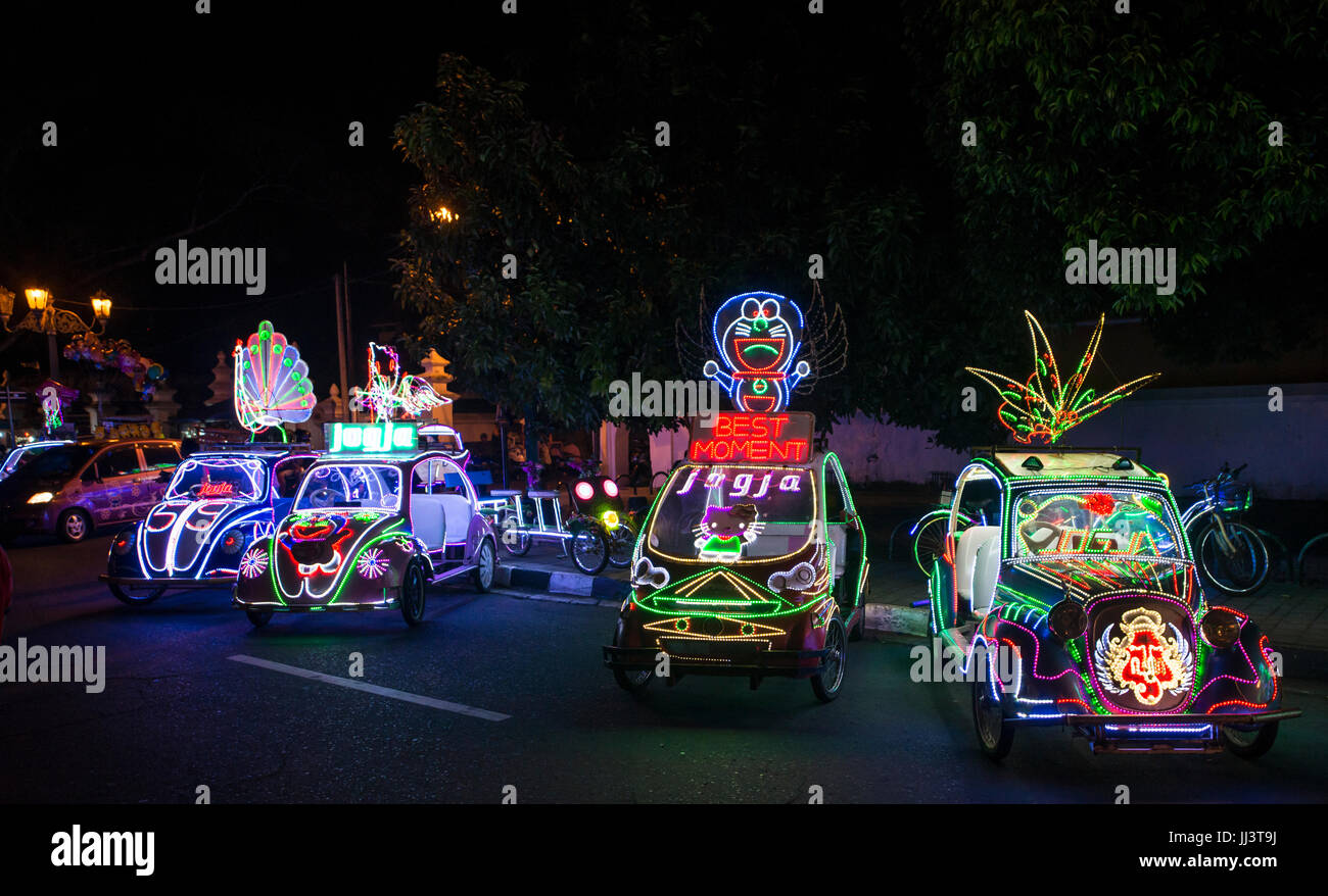 Colorful with LEDs illuminated cars, pedal car, Yogyakarta, Java
