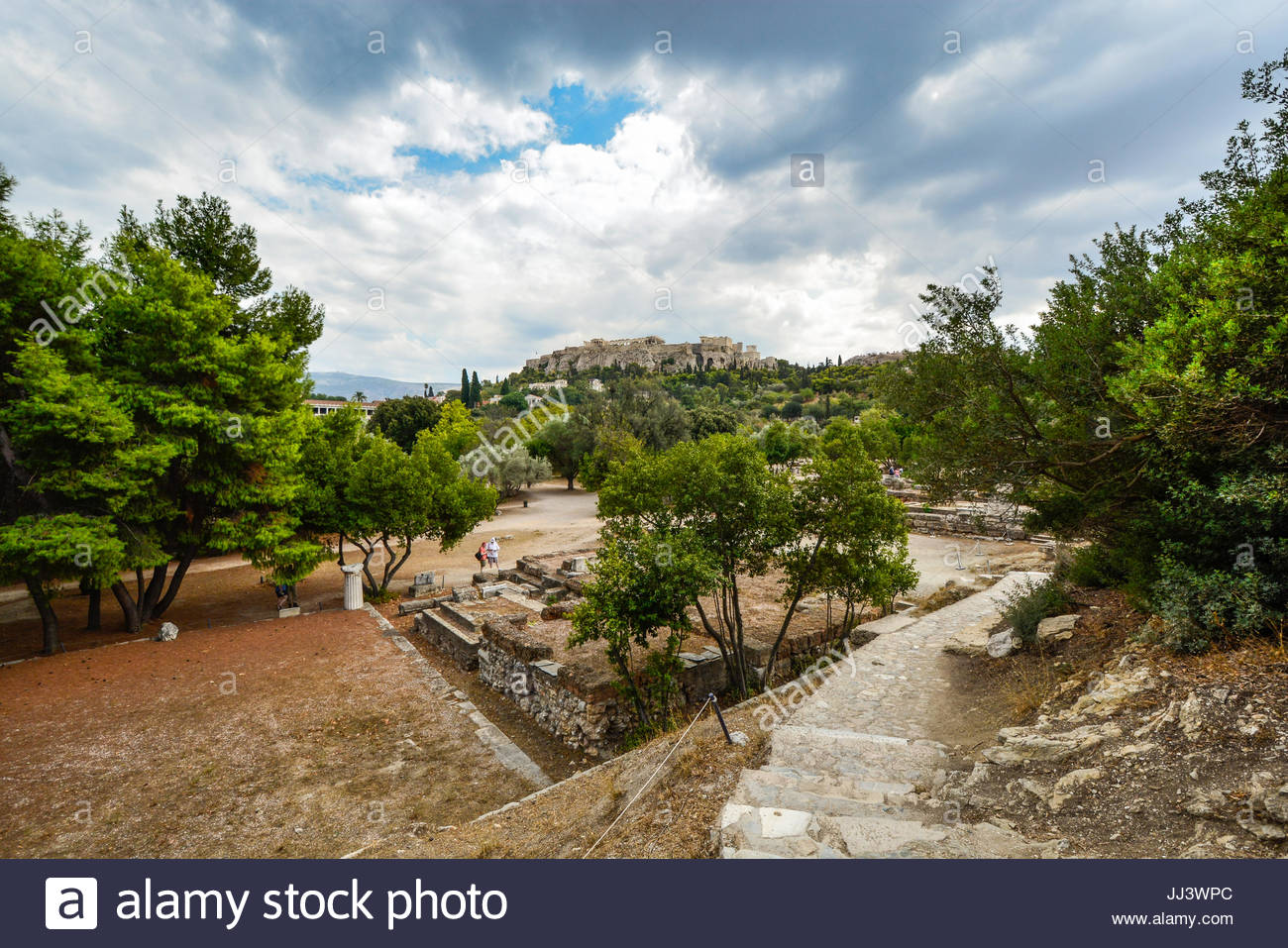 Looking up at Acropolis Hill and Parthenon in Athens Greece from the agora below on a cloudy day in late summer - Stock Image