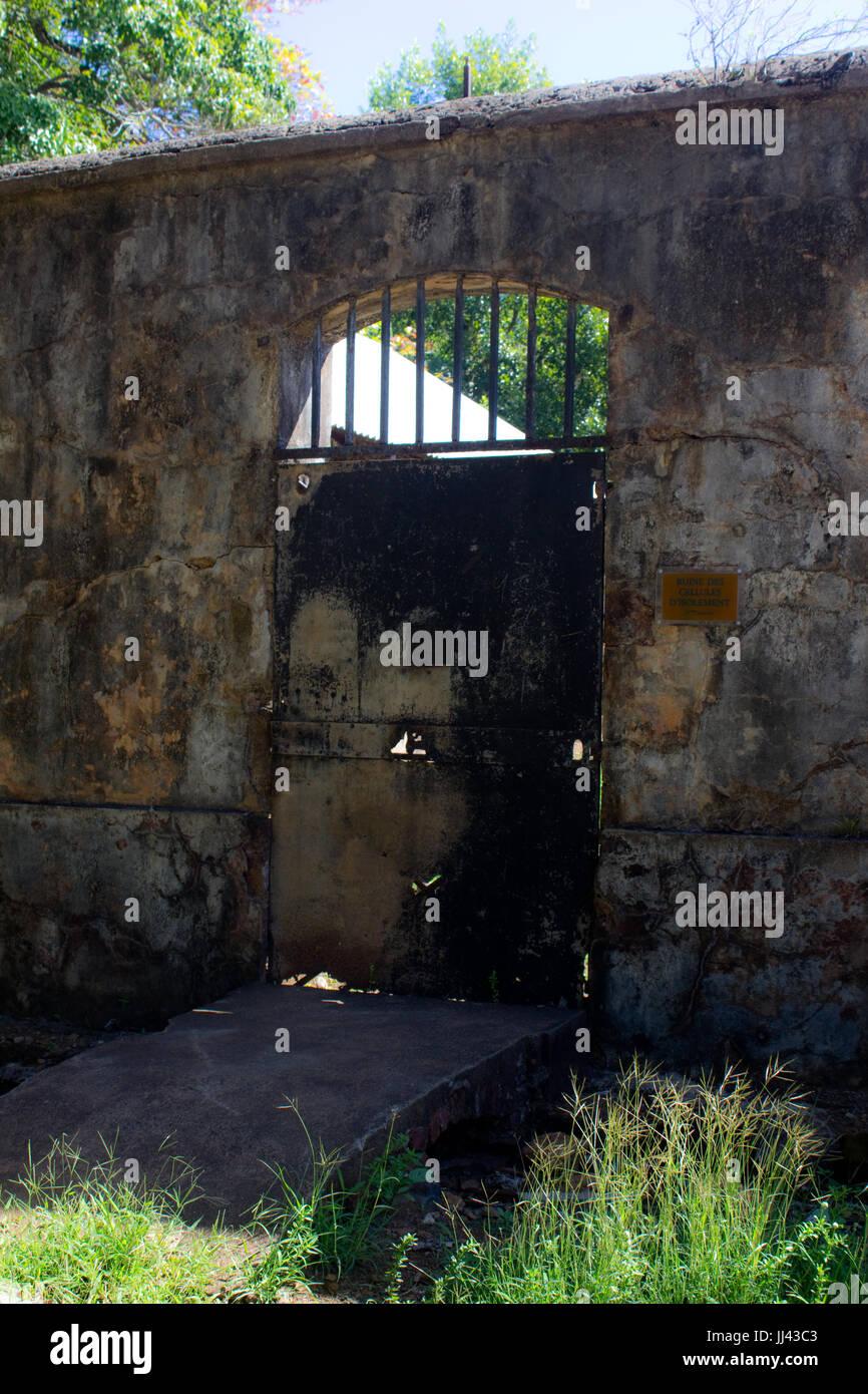 A gateway through a prison wall. - Stock Image