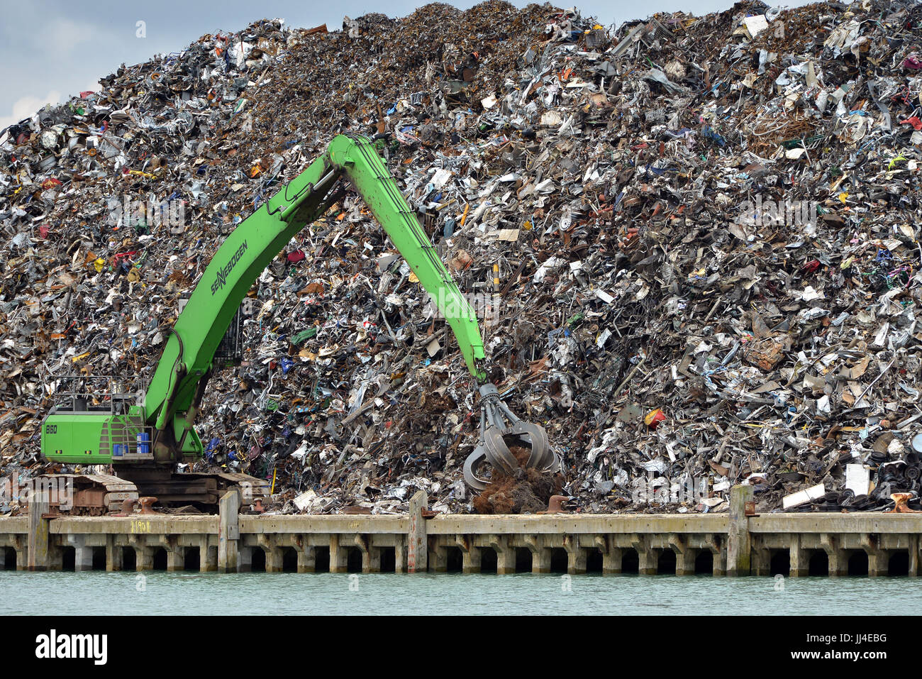 Scrap metal pile waiting for recycling with crane, Newhaven port, East Sussex - Stock Image
