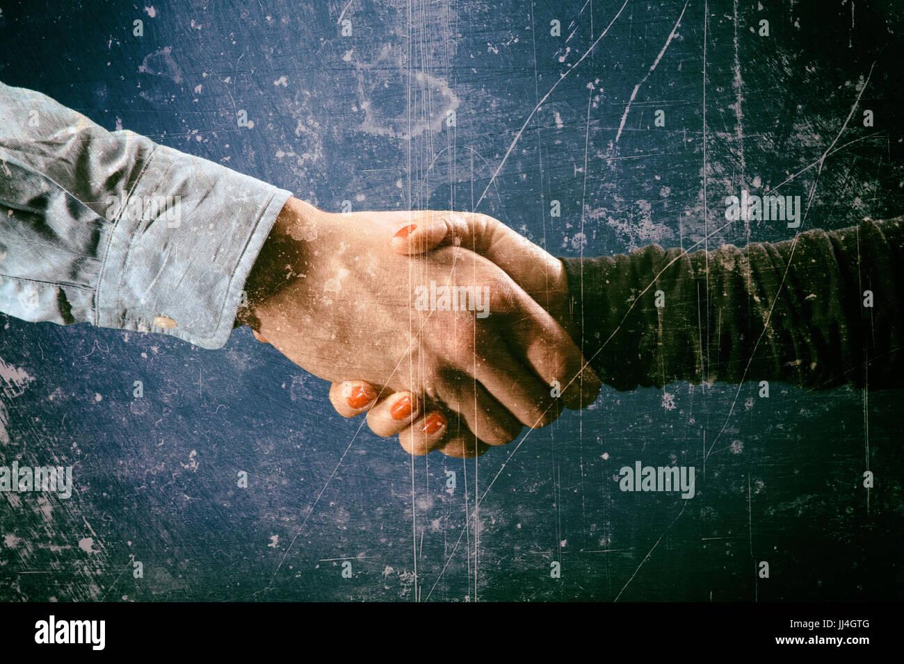 Grunge style handshake of businessman and businesswoman - Stock Image