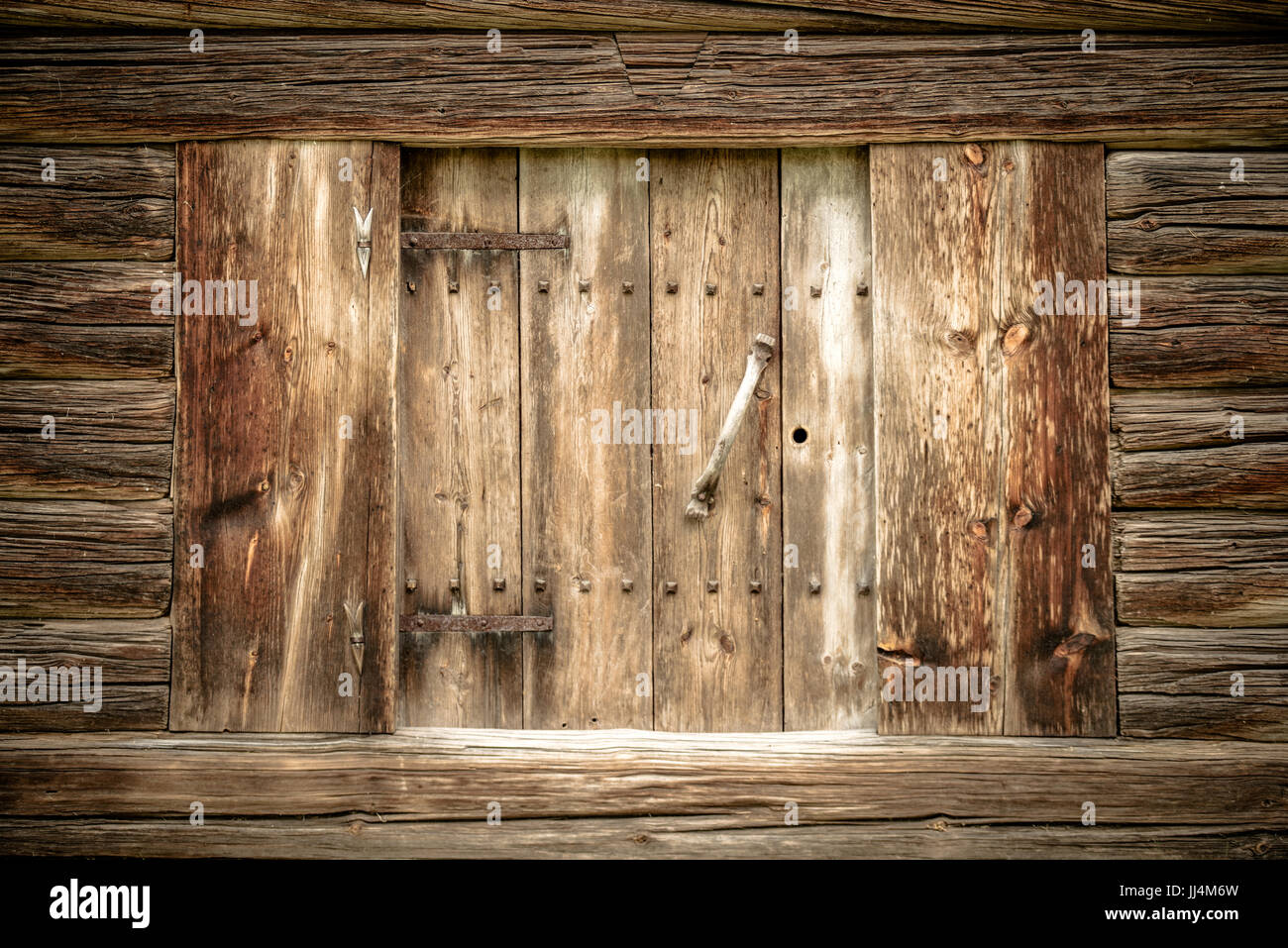Old traditional handcrafted door in wooden house located in the garden of the Zorn house in Mora, Dalarna, Sweden. - Stock Image