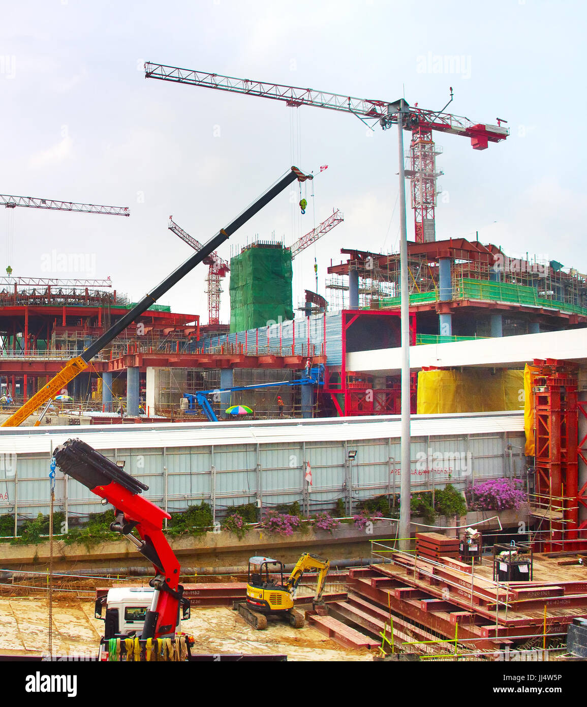 Work in progress at a construction site of a modern airport terminal. Singapore - Stock Image