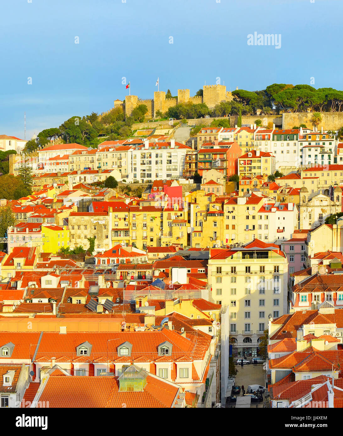 View of Lisbon with Lisbon Castle on top of a hill at sunset. Portugal Stock Photo