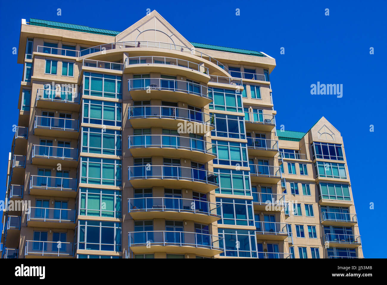 Large Multi Story Building With Balconies - Stock Image
